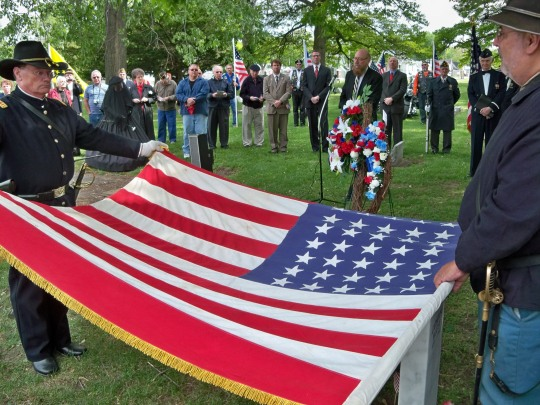 The furling of a Civil War era flag at the Martin McHugh Ceremony, April 21, 2012