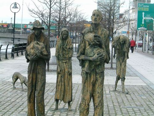The Famine Memorial in Dublin. Those emigrants who departed have lost their individualism, their later stories subsumed into an image of the Irish diaspora (Image via wikipedia)