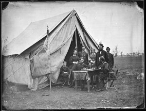 Colonel James P. McMahon (seated, facing camera) plays chess at the headquarters of the 164th New York (Library of Congress)