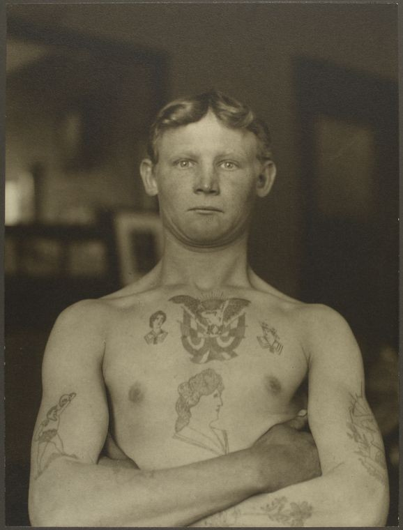 A German Stowaway at Ellis Island. Although taken in 1911 this gives an idea of the types of tattoos prevalent (New York Public Library)