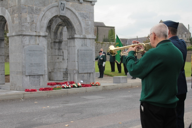 'The Last Post' is played at the Tipperary Remembrance Arch (Sara Nylund)