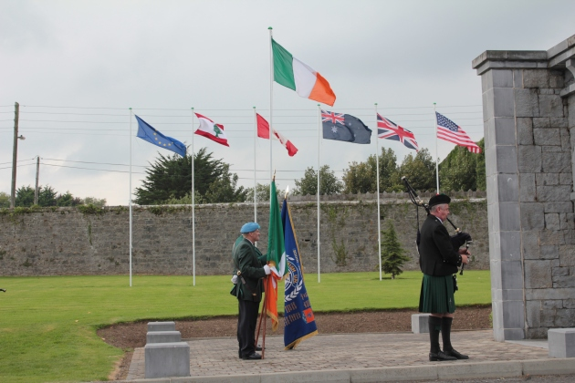 'Going Home' is played by a lone piper at the ceremony (Sara Nylund)