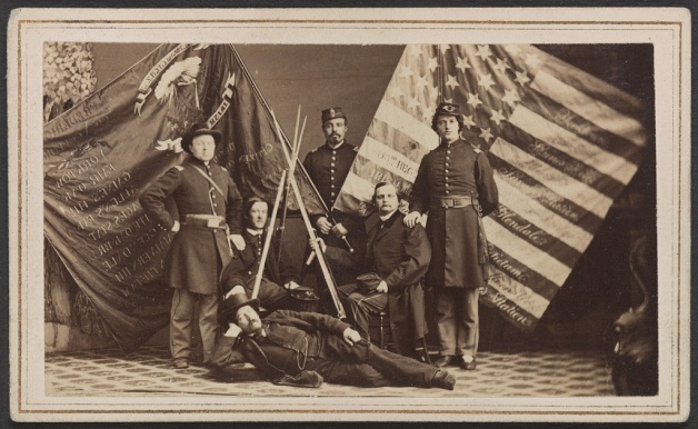 Officers of the 63rd New York Infantry with their Colors. This image was likely taken in late 1863/ early 1864 (Library of Congress)