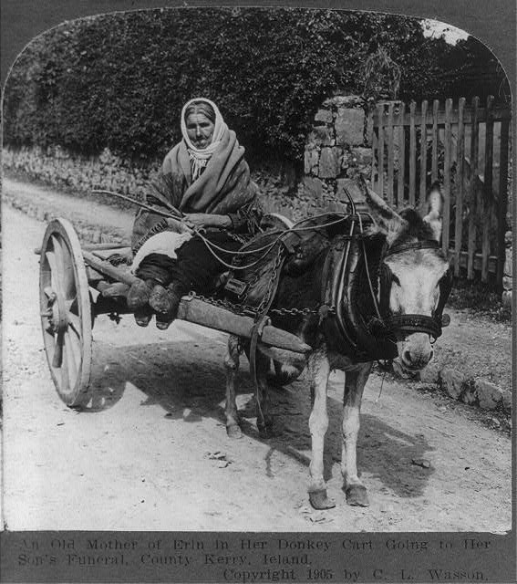 An elderly Kerry woman on the way to her son's funeral c. 1905. It was in the hope of a better life that Catherine Long took her family to the United States in the 1840s. (Library of Congress)
