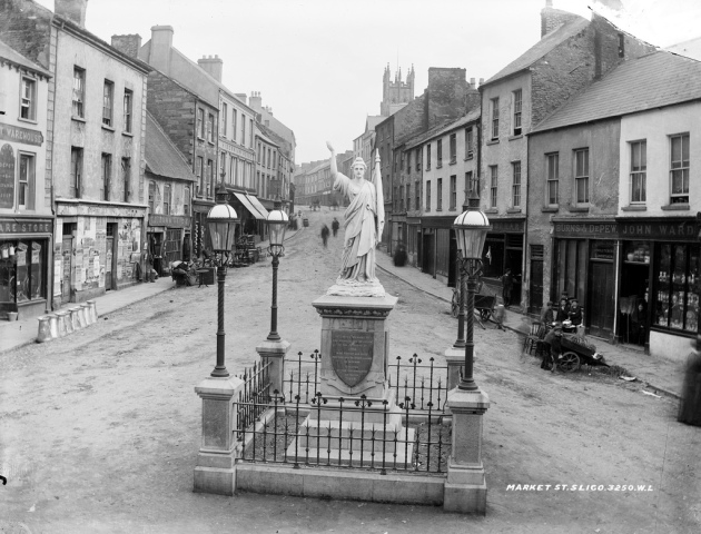 Market Street Sligo c. 1899. Aside from the new 1798 memorial in the foreground this streetscape would probably have been familiar to both Patrick and John Finan (National Library of Ireland)