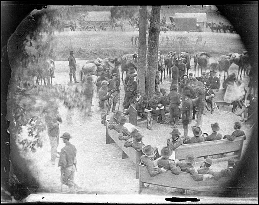 Massaponax Church, Virginia. 'Council of War' General Ulysses S. Grant (left end of bench nearest tree) writing a dispatch, May 21, 1864 (Timothy O'Sullivan/ Library of Congress)