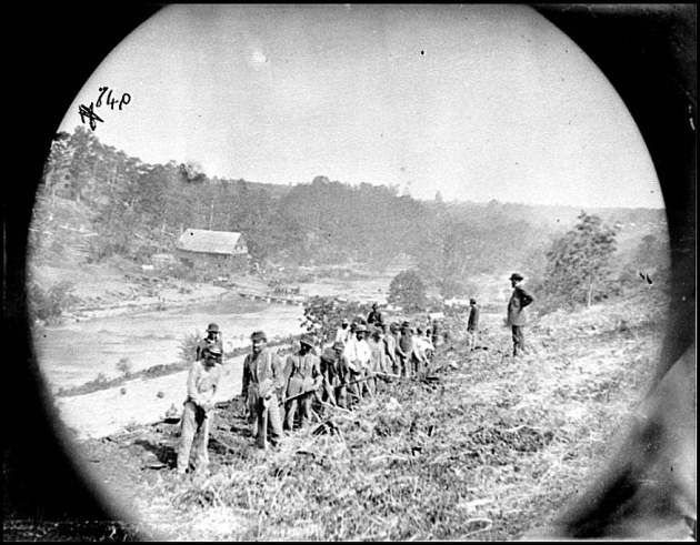 Jericho Mills, Virginia. Party of the 50th New York Engineers building a road on the south bank of the North Anna, with a general headquarters wagon train crossing the pontoon bridge, May 24, 1864 (Timothy O'Sullivan/ Library of Congress)