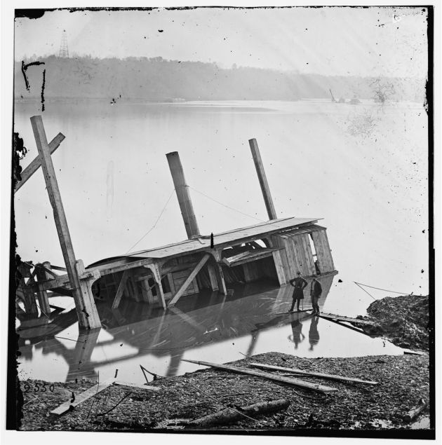 """'...Having hit the """"Mud Digger,"""" at the canal, in the ribs and sent her to the bottom.' General Butler's forces were engaged in an ultimately unsuccessful project which involved digging a canal to try and bypass some of the Confederate batteries on the James. This photo is the dredge boat that 'Garryowen' witnessed sinking on Thanksgiving Day 1864 (Library of Congress)."""