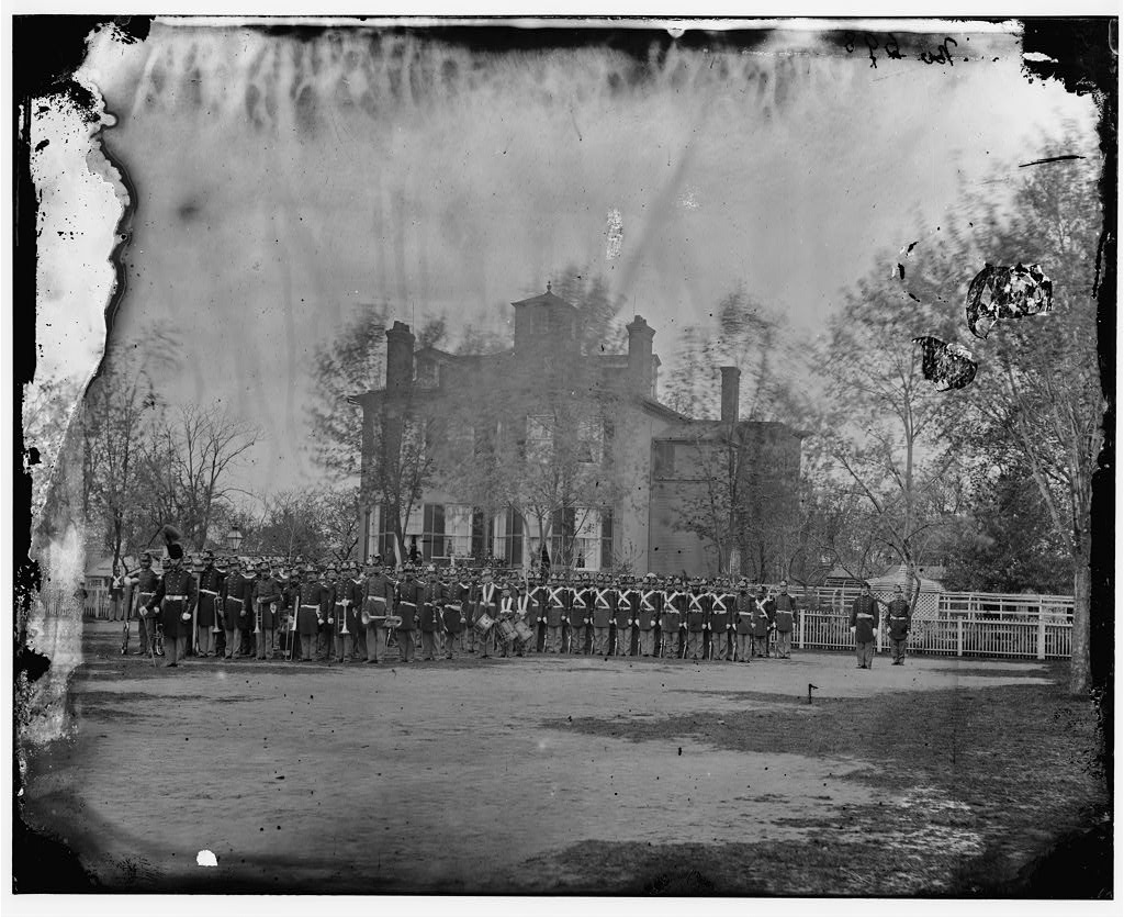 A United States Marine Corps Battalion in front of the Commandant's House, Marine Barracks, Washington D.C. in 1864. Charles O'Donnell never get any further than these barracks during his brief military career in 1862 (Library of Congress)