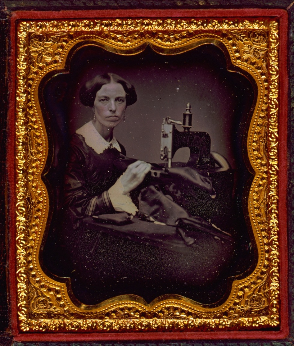 A woman enjoying her new sewing-machine, c. 1853 (Library of Congress)