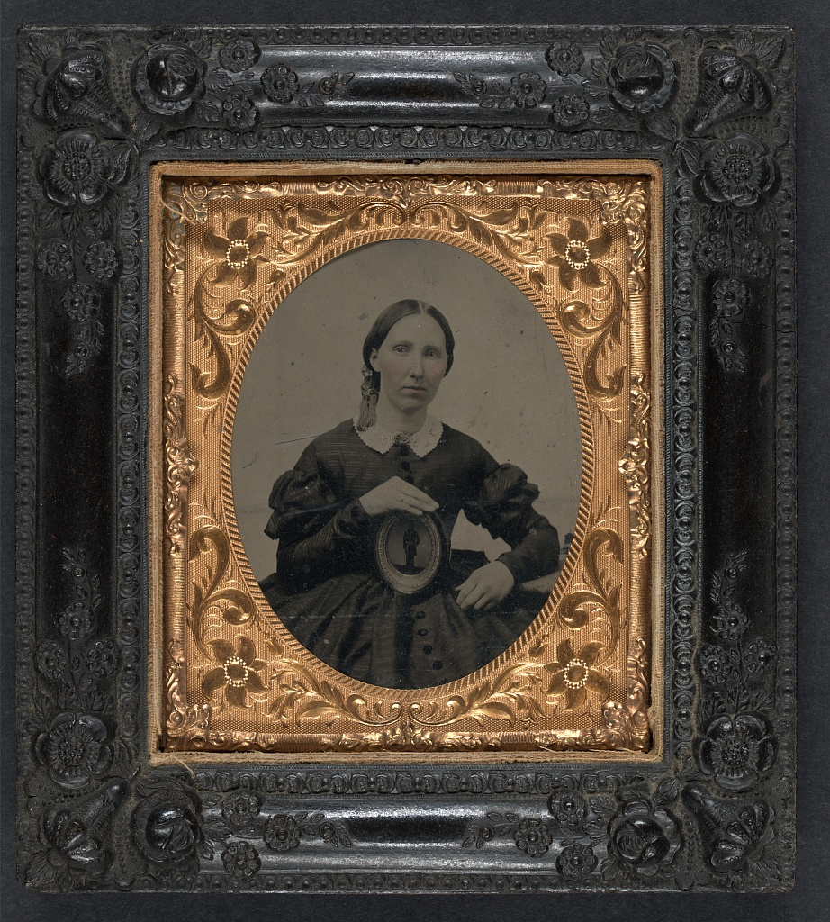 A woman in mourning clothes holds an image of her husband during the Civil War (Library of Congress)