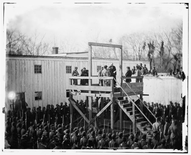 Alexander Gardner captured a series of images of Henry Wirz's execution in Washington D.c. on 10th November 1865. Here the Death Warrant is being read to Wirz on the Scaffold (Library of Congress)