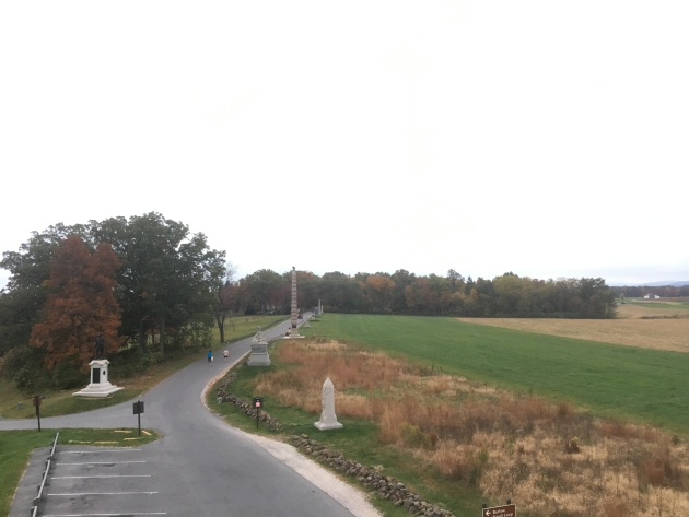 Looking south along Doubleday Avenue on Oak Ridge and the memorials that mark the First Corps line. The 94th NEw York memorial is located just before the woods (Damian Shiels)