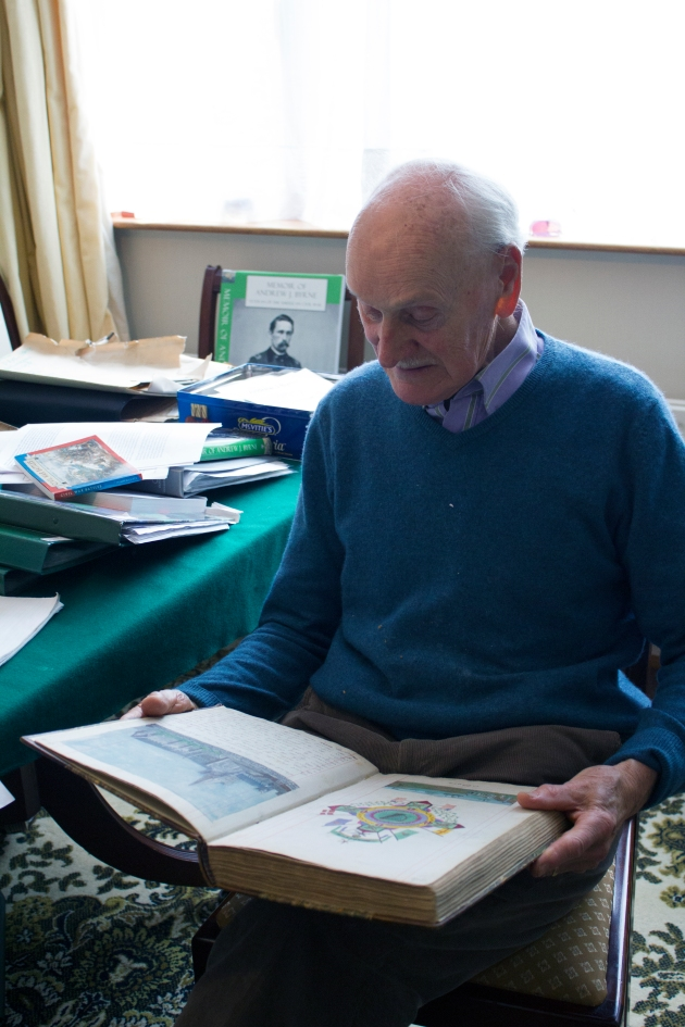 Seamus Condon with the handwritten and handillustrated memoirs of his grandfather, Andrew J. Byrne, 65th New York Infantry
